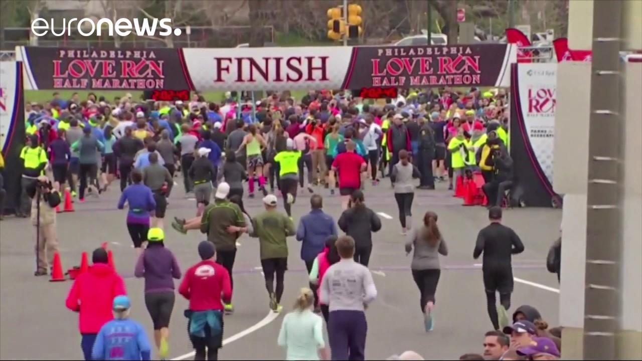 825a6682d66d9 Runner carried across the finish line at Philadelphia half marathon ...