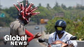 "Coronavirus Outbreak: Indian Police Use The ""coronahelmet"" To Raise Awareness During Lockdown"