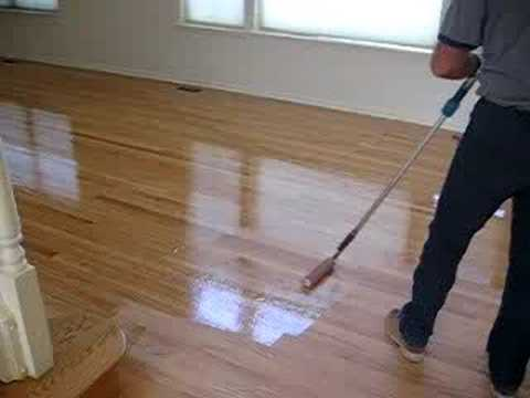 hardwood floors applying final coat - YouTube