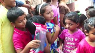Poonam Pandey Distribute Raincoats To Street Childrens