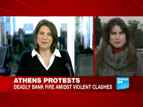 Greek anti-austerity march turns violent; Three die as bank firebombed