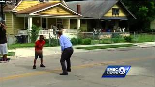 Police officers stop for basketball game with KC kids