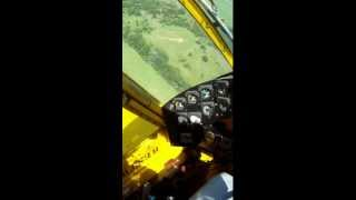 Air Tractor spraying pasture helmet cam