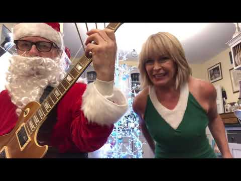 """Robert Fripp & Toyah Willcox Sing the Sex Pistols' """"Anarchy in the UK"""" While Dressed as Santa and Elf"""