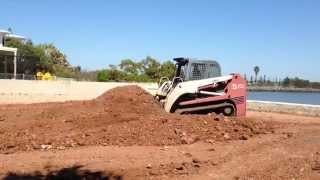 TAKEUCHI TL150 Rubber track loader doing what it dose best moving dirt