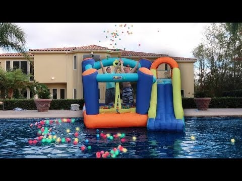 THROWING GIANT BOUNCY HOUSE IN THE POOL!!! **DON'T ATTEMPT**