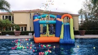 THROWING GIANT BOUNCY HOUSE IN THE POOL!!! **DON'T ATTEMPT** thumbnail