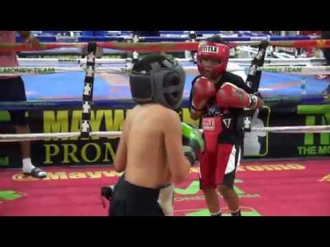Young kids sparring inside Mayweather Boxing Club