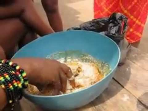 3 Togo Girls eating Garri or tapioca popular West African food cassava tubers.