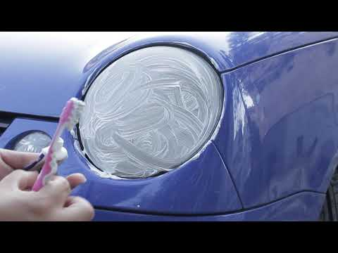 Testing cleaning car headlights with toothpaste