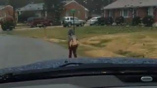 Dad teaches son a lesson, makes him run to school in rain - Daily Mail