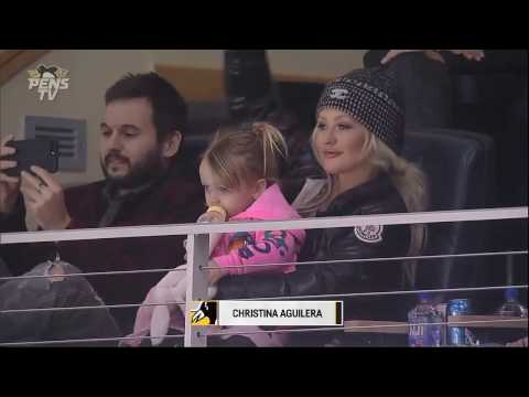 "[1/2] Christina Aguilera & Family at the ""Penguins vs. Hurricanes"" Game in Pittsburgh (28/Dec/06)"