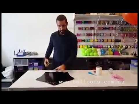 Vinyl transfer tips onto foil balloons
