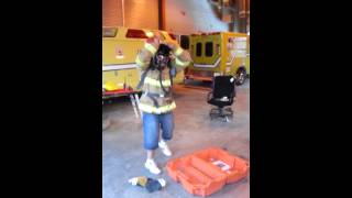 Firefighter dons SCBA under 30 secs
