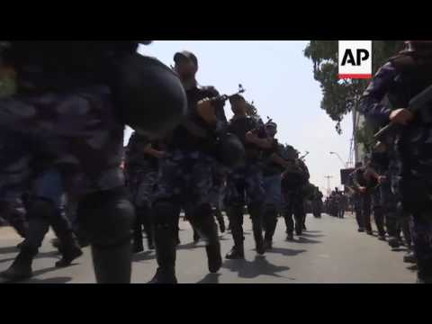 Hamas forces march over disputed holy site