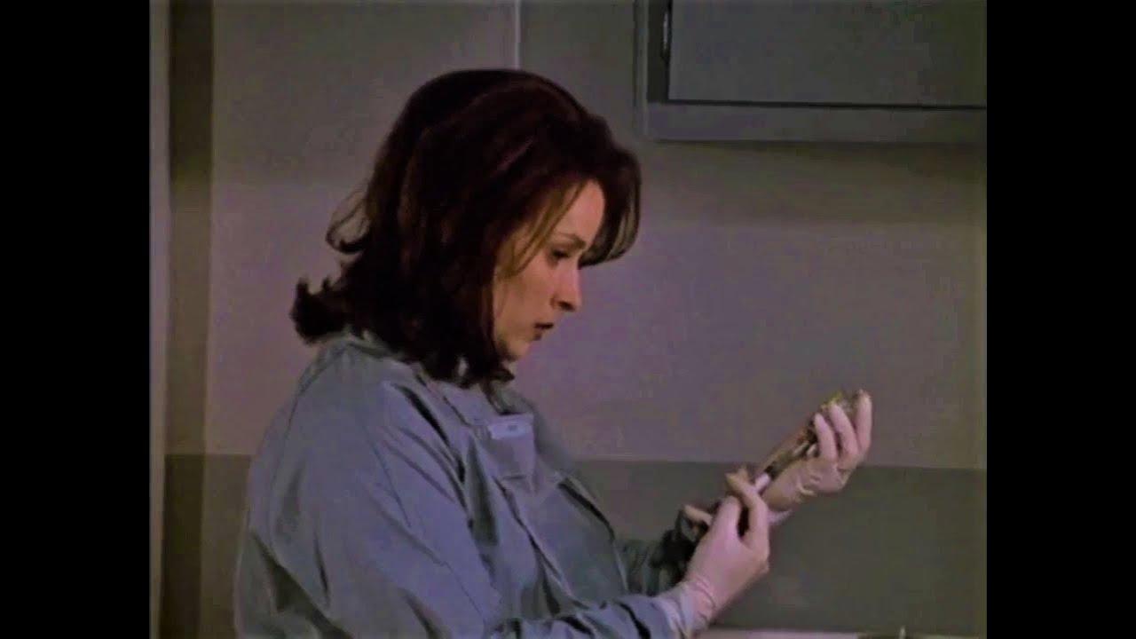 Denise Miller in latex gloves