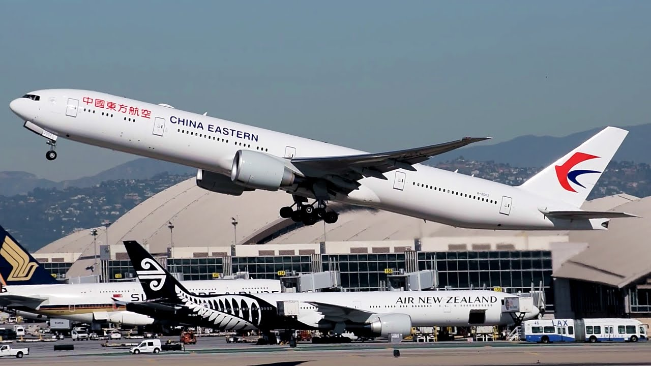 China eastern airlines boeing 777 300er b 2002 departing - China eastern airlines sydney office ...
