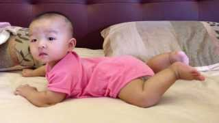 Initial stage of Baby learning how to crawl during her tummy time