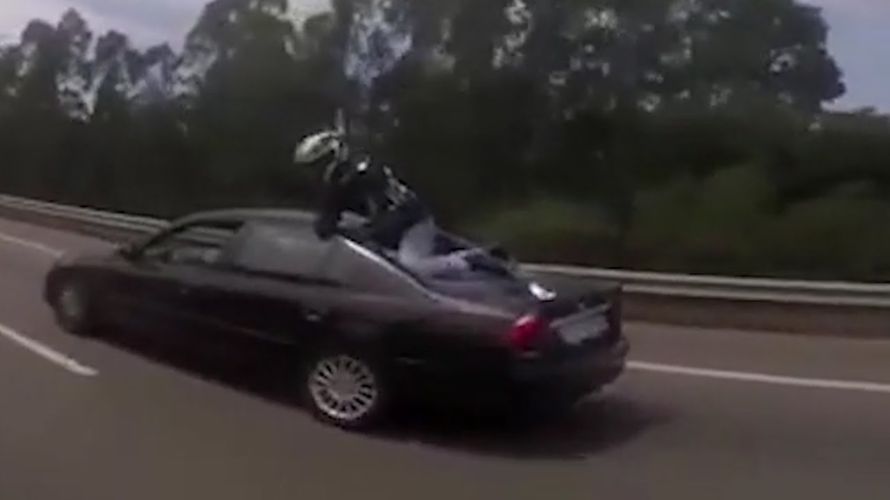 Biker Cheats Death By Jumping On A Car Following A High Speed