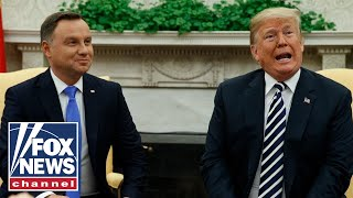 Trump holds joint press conference with Polish president