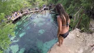 Leaping into Cenote Azul