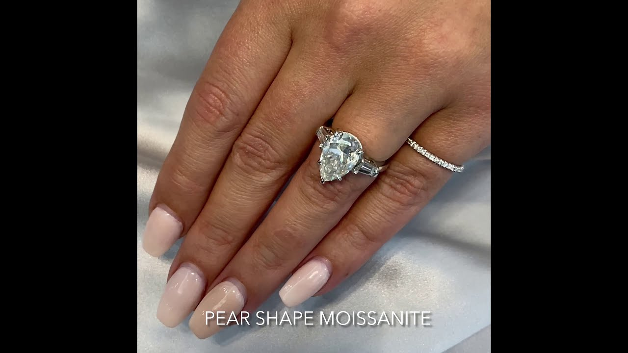 Pear Shape Moissanite Three-Stone Engagement Ring
