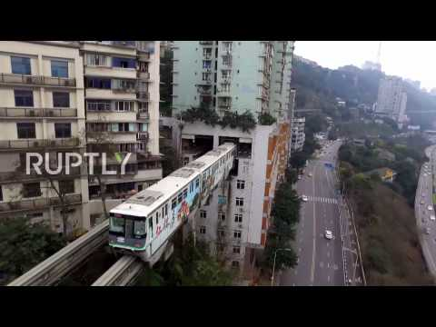 China: Grab your ear plugs! This train literally runs straight through a block of flats