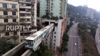 China: Grab your ear plugs! This train literally runs straight through a block of flats thumbnail