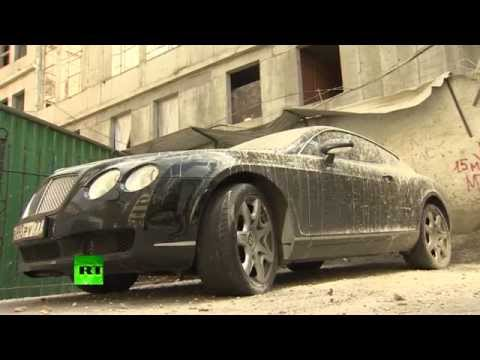 Only in Russia: Bentley supercar caked in concrete in Moscow