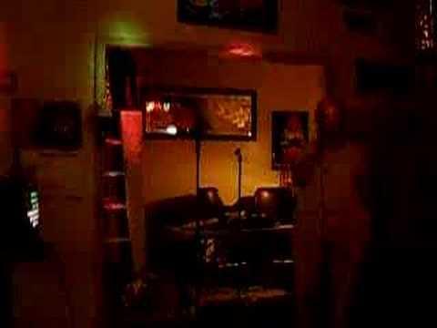 "Judy karaoke-ing ""Pussy Cat"" song"