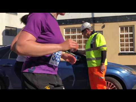 Woman Running Late Drives onto Marathon Course