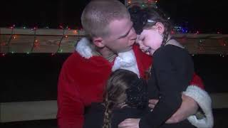 Soldier 'Santa Grinch' surprises his daughters
