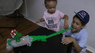 Kids play with Mario Kart Piranha Plant Slide Track