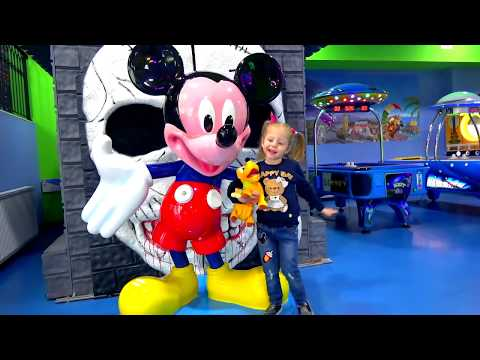 Funny Kid and Toy's dog Pluto playing on the indoor playground for kids Play and Area for children