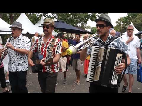 The Sentosa Trio marching the alleys of the North Sydney Community Food Markets
