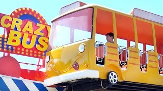 Vlad and Kirill playtime in the amusement park / The wheels on the bus song for kids