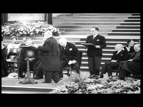 Clement Attlee stands at a podium to offer good wishes to Winston Churchill on hi...HD Stock Footage