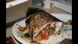 Как приготовить карпа в духовке, фаршированного овощами.