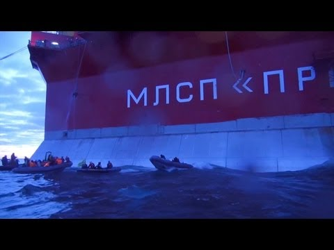 Greenpeace activists attempt to scale Russian oil rig