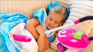 Diana Pretend Play with toy vacuum cleaner