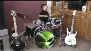 7 Year Old Kid playing drums to Holiday by Green Day