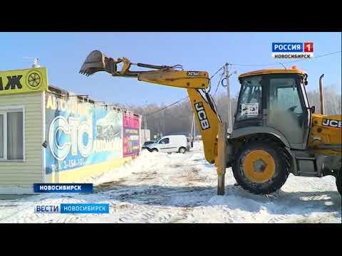 В Новосибирске судебные приставы и спецназ закрыли и снесли здание СТО