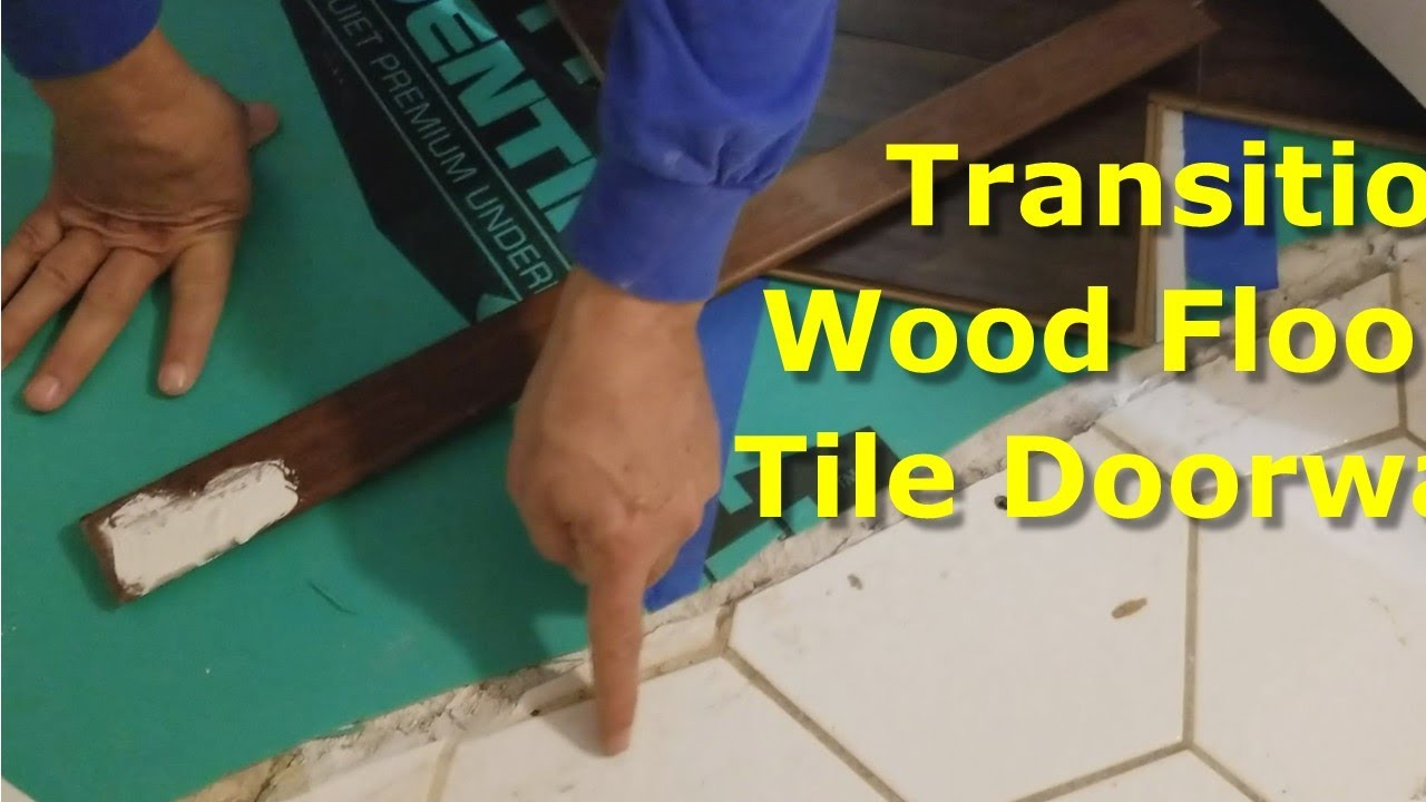how to transition laminate floors wood floor to tile at door