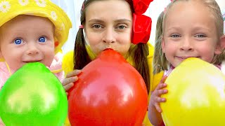 Maya and little baby Mary play with balloons