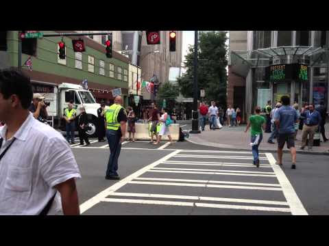 Craziest traffic cop...ever. Steals the show during the DNC.