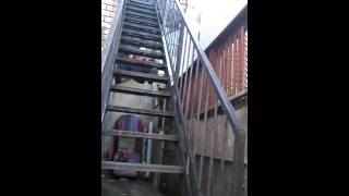 People climbing up the stairs backwards