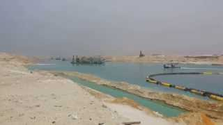 In a scene of Dredging March 28, 2015