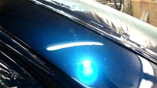 Left rear quarter panel. No more Key marks or dings. Resprayed the ...