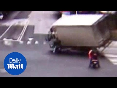 Scooter rider nearly crushed to death by lorry in China - Daily Mail