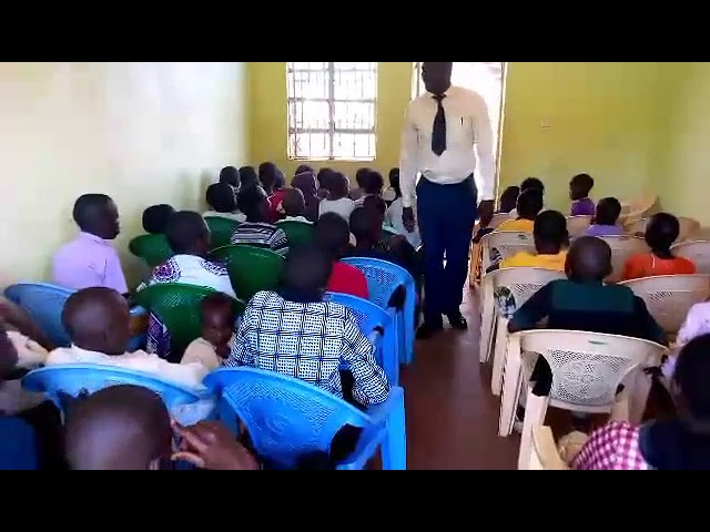 Brother Haron Leading Children in Worship GMFC / WFF Moi's Bridge Kenya